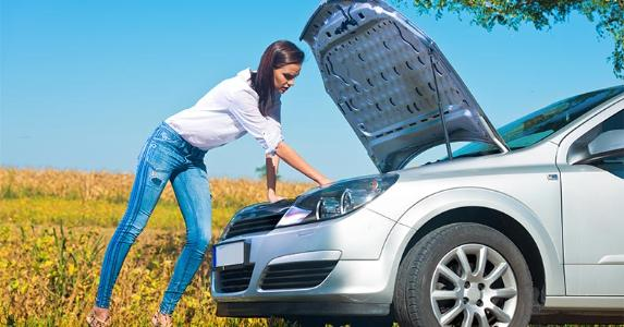 woman-checking-under-hood-of-car